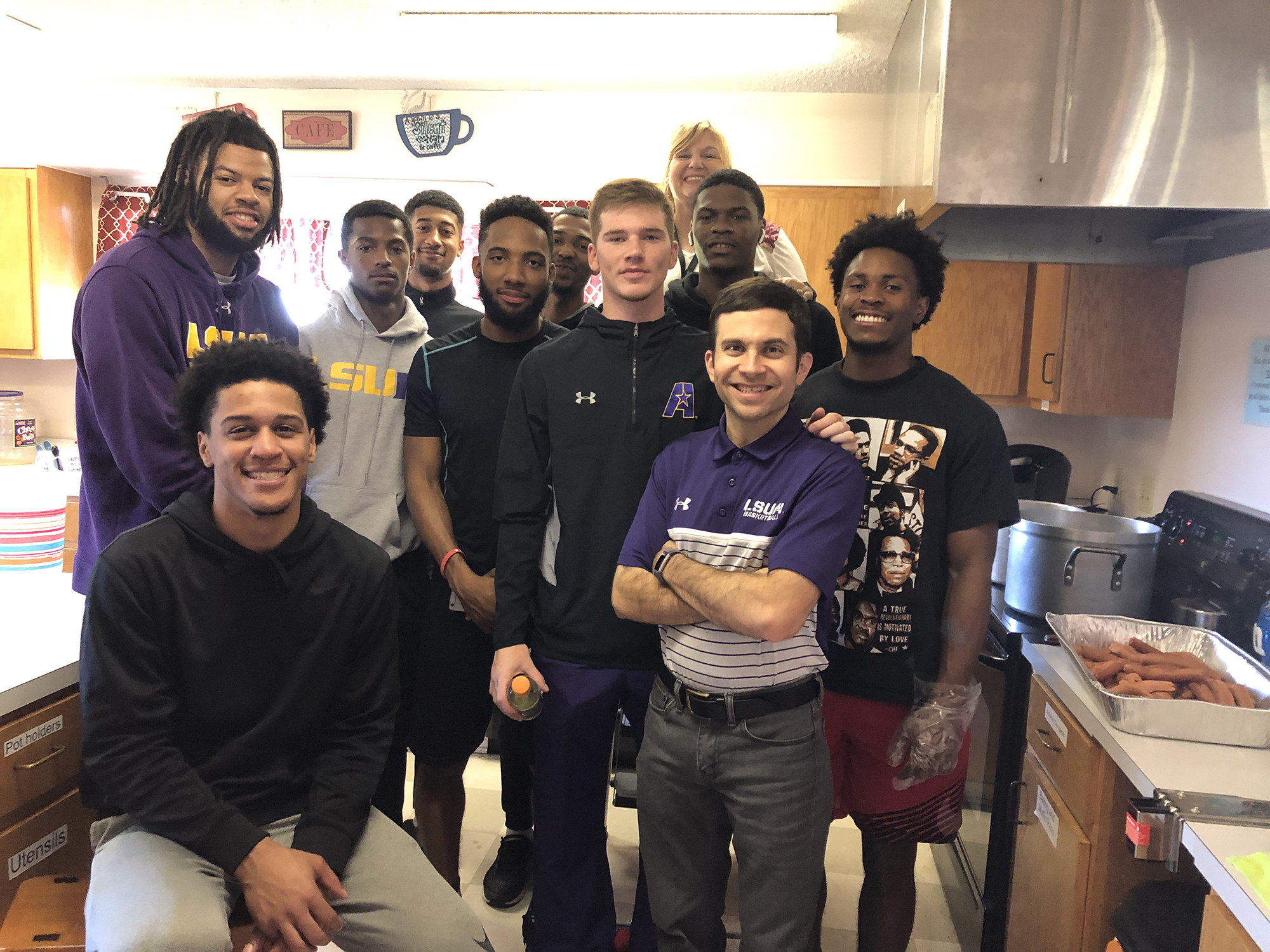 Coach Larry and the LSUA Basketball team served lunch at the LSUA Catholic Student Center recently.
